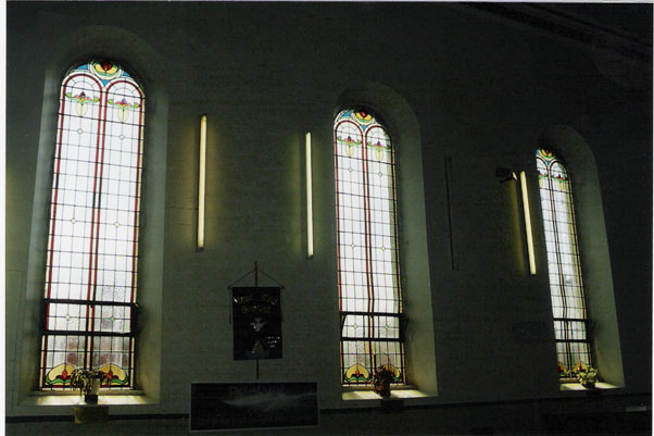 Photograph from the 1990s showing the windows fitted in 1938. Replaced in 2001 due to bowing and rust.