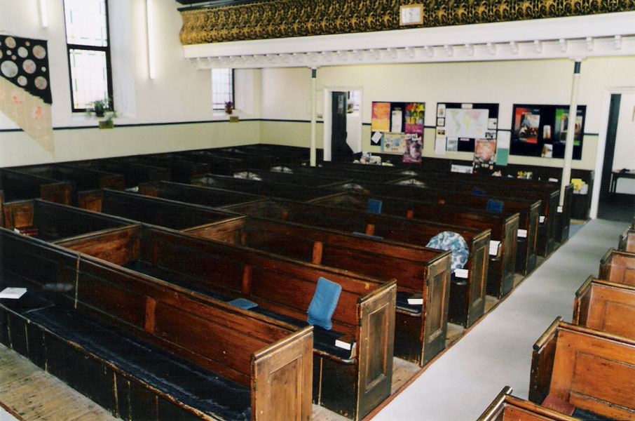 A view of the pine pews just prior to their removal. Note the pew runners that had been obtained during 1989 from Brown Street Baptist Church, Salisbury to prevent people sticking to the varnish during hot weather.